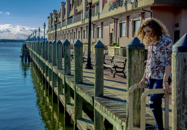 A girl looking into the water. thumbnail