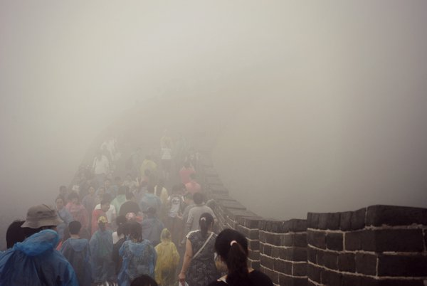 Climbing the Great Wall of China as it slowly appears from the fog thumbnail