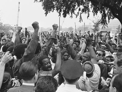 Civil rights leader Rev. Ralph Abernathy, in short sleeves, leads the Poor People's March to the edge of the grounds of the U.S. Capitol building in Washington, June 24, 1968. Abernathy and his followers from Resurrection City marched to the Agriculture Department and then to the Capitol.