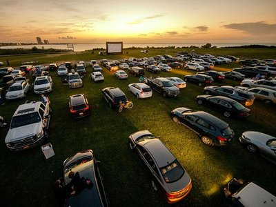 Attendees arrive to watch the movie Grease at a pop-up drive-in theatre at Bucktown Marina Park on May 22, 2020 in Metairie, Louisiana.