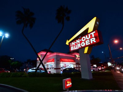 Drivers wait in the drive-thru line at an In-N-Out Burger restaurant in Alhambra, California, on August 30, 2018.