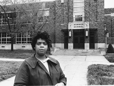 This May 8, 1964 file photo shows Linda Brown Smith standing in front of the Sumner School in Topeka, Kansas.