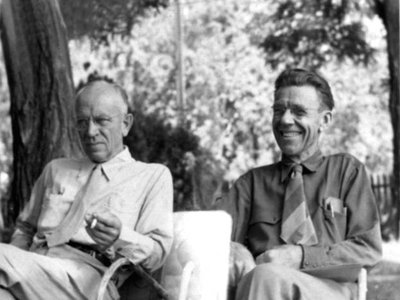 Aldo Leopold (left) and Olaus Muire sitting together outdoors, annual meeting of The Wilderness Society Council, Old Rag, Virginia, 1946