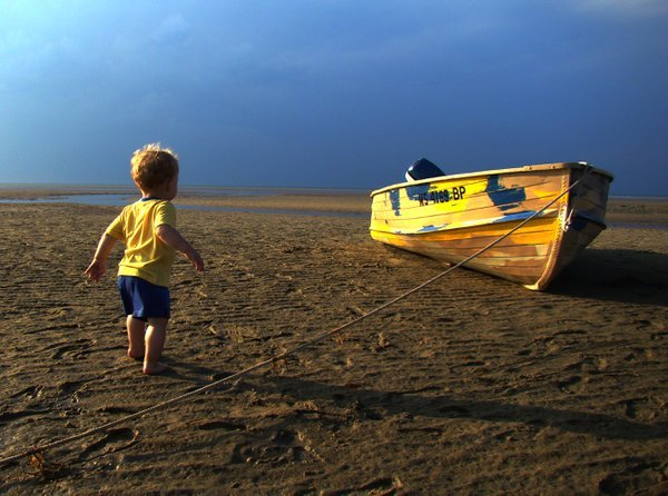 A child and a boat.