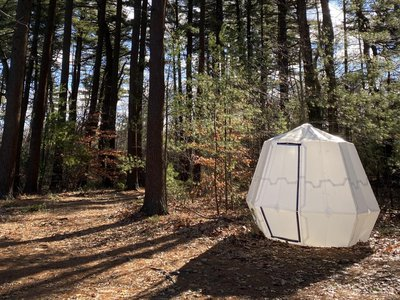 An origami-inspired tent had to be flexible enough to inflate, but sturdy enough to withstand the elements.
