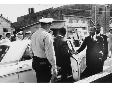 Martin Luther King Jr. and Reverend Ralph Abernathy are taken in for questioning by Birmingham police in 1962.