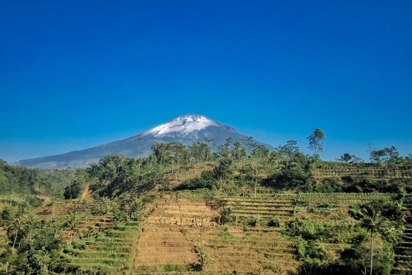 Beautiful morning view at the highland of Central Java, Indonesia. Mount Sumbing and clear blue sky just so wonderful scenery to see thumbnail