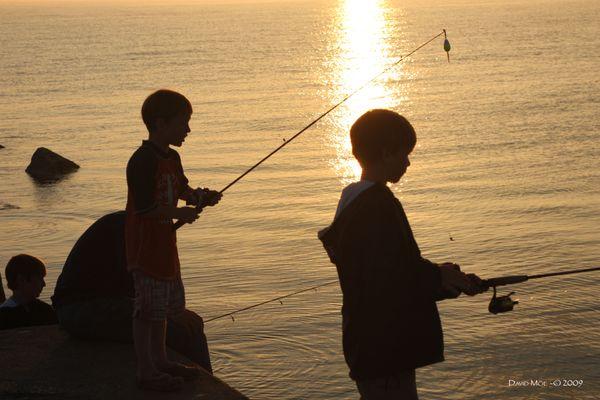 Boys fishing off the Ludington Breakwater thumbnail