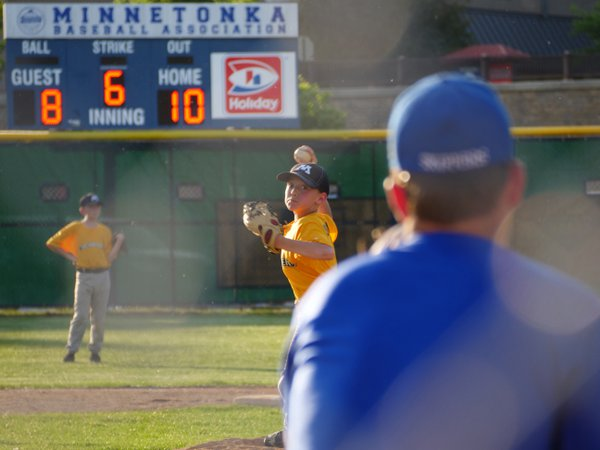 Warming up pitches between innings at little league field in Minnetonka, MN thumbnail