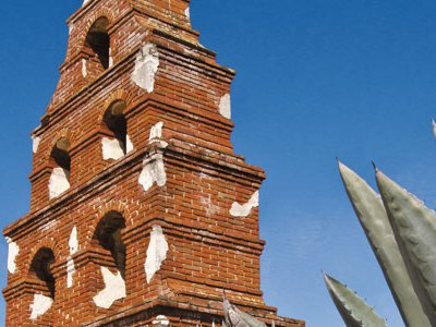 The missions—built between 1769 and 1823 and extending in a chain of 600 miles from Sonoma to San Diego—stand as symbols of California's Spanish colonial past. Pictured is San Miguel's bell tower.