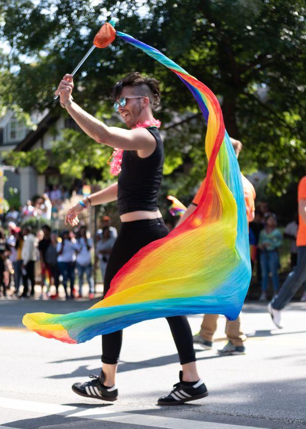 Flow artist marches during Atlanta pride parade. thumbnail