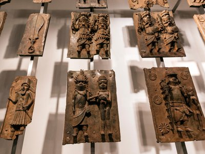 Some of the hundreds of brass plaques taken from Benin City in 1897 now held by the British Museum