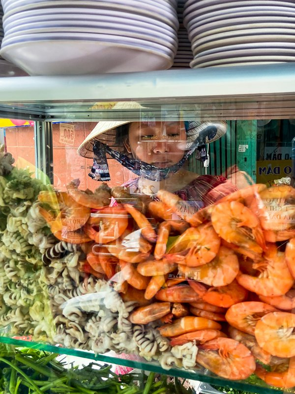 A street food vendor in one of the famous street markets of Ho Chi Minh thumbnail