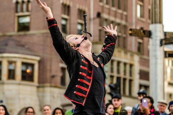 A street performer swallows a sword thumbnail