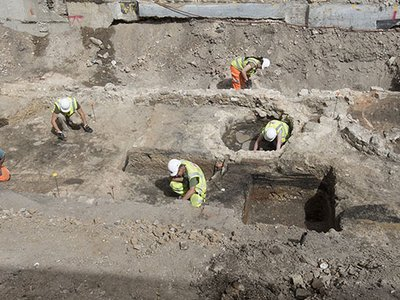 Archaeologists excavate the outside areas of the Theater.