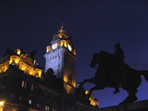 Edinburgh's Balmoral Hotel with a statue of the Duke of Wellington in the foreground thumbnail
