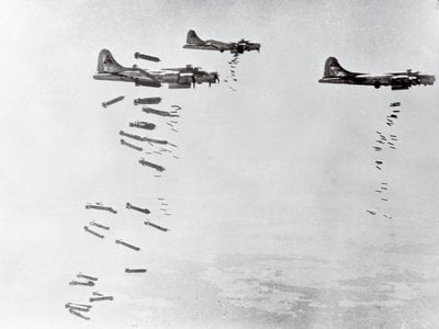 Flying Fortresses of the 303rd bomber group (Hell's Angels) drop a heavy load on industrial targets in Germany.