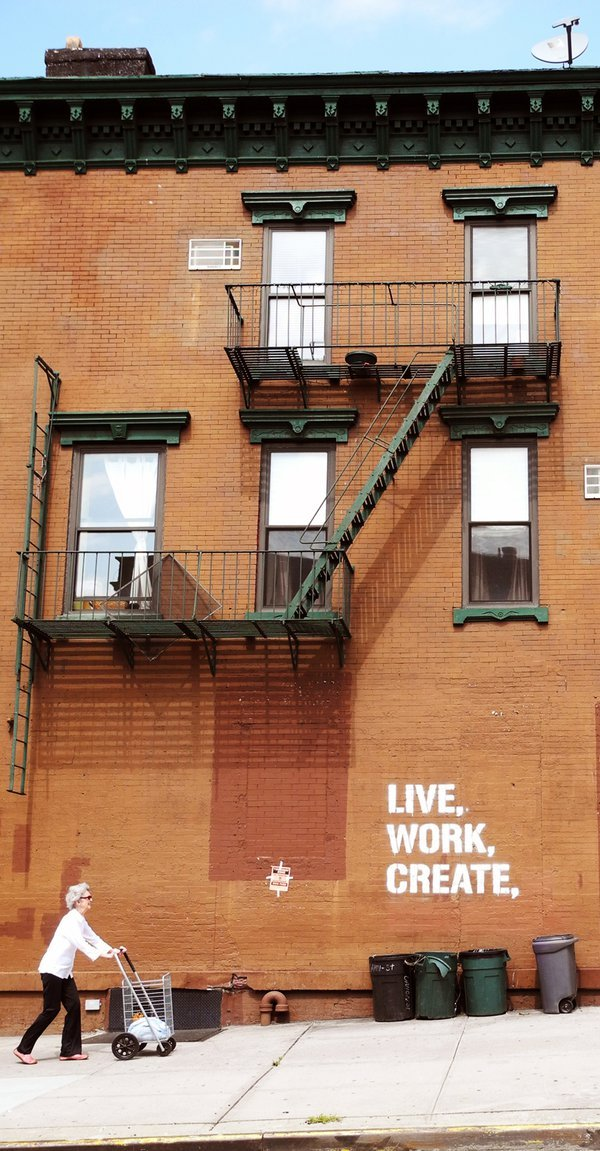 "Elderly lady walking up the hill on Park Slope, Brooklyn, NY. Wall graffiti reads ""LIVE, WORK, CREATE."" thumbnail"