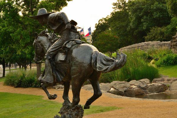 Bronze Statue of a Cowboy Riding Hard thumbnail