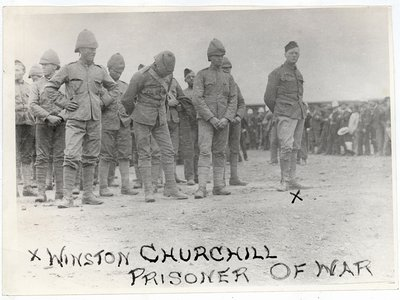 """""""Three days after the attack on the armored train, Churchill arrived in Pretoria, the Boer capital, with the other British prisoners of war. Surrounded by curious Boers eager to see the new prisoners, he glared back at them with unconcealed hatred and resentment. Although he respected the enemy on the battlefield, the idea that average Boers would have any control over his fate enraged him."""""""