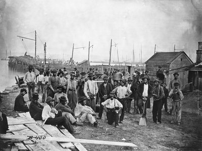 A group of freed African American men along a wharf during the Civil War.