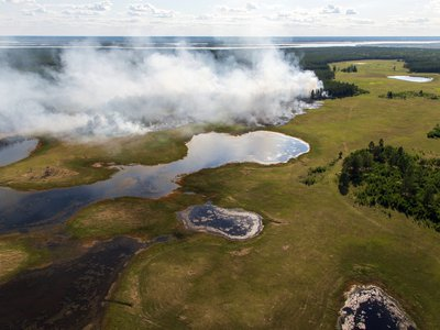 A fire in the Yakutia region of Siberia in early June seen from the air. A June heat wave saw temperatures in Verkhoyansk, a town in Yakutia, hit 100 degrees Fahrenheit.