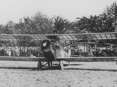 """A Curtiss """"Jenny"""" biplane carrying mail for Philadelphia, Pennsylvania, before takeoff from the Polo Grounds in Washington, D.C."""