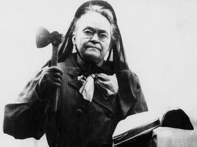 Carry A. Nation with her bible and her hatchet not long before she died in 1911.
