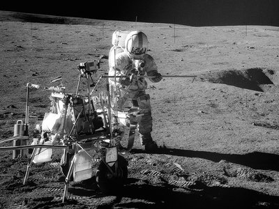 Apollo 14 Astronaut Alan B. Shepard Jr. assembles equipment on the lunar surface on February 6, 1971.