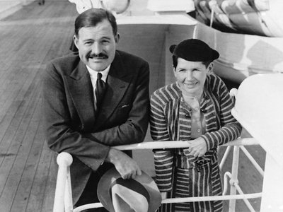 """Hemingway enters New York Harbor with his second wife, Pauline Pfeiffer, aboard the ocean liner Paris on April 3, 1934. He described her as """"clever and entertaining and full of desire."""""""