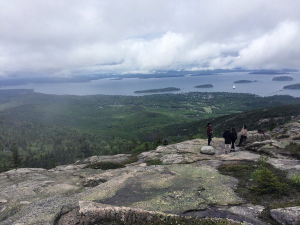 Hikers overlooking Cadillac Mountain thumbnail