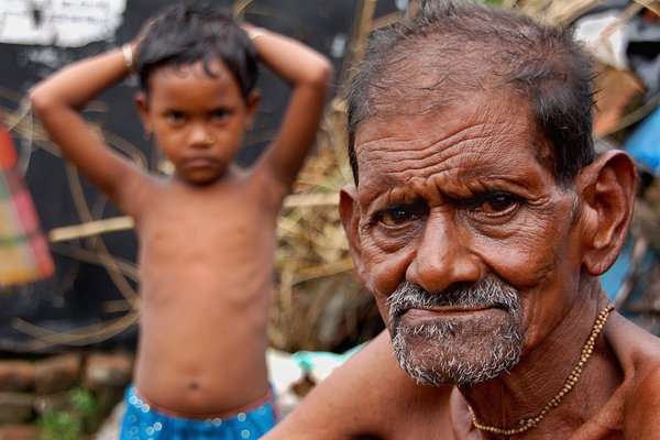 generation next-an old villager with his grand daughter thinking about her future. thumbnail
