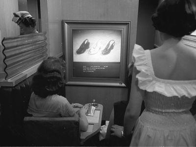 Women compare A.J. Freiman shoes.