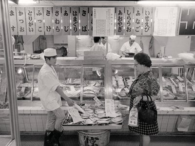 Archival image, July 9, 1973: (Original caption) A woman seems hesitant about buying fish at a shop in Tokyo recently (June 25) after the Japanese Health and Welfare Ministry's June 24th warning that no one should eat more than 567 grams (about one pound four ounces) of fish a week to avoid the possibility of dangerous mercury poisoning.