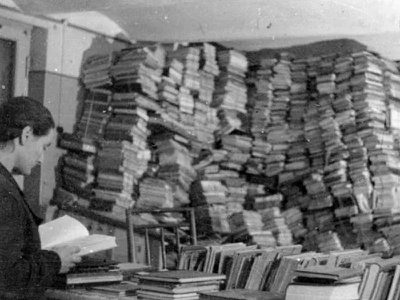 The Einsatzstab Reichsleiter Rosenberg looted books across occupied Europe. Pictured here is a room full of stolen texts in Riga, Latvia.