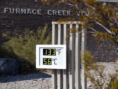 """Via Getty: """"An unofficial thermometer reads 133 degrees Fahrenheit at Furnace Creek Visitor Center on July 11, 2021 in Death Valley National Park, California."""""""