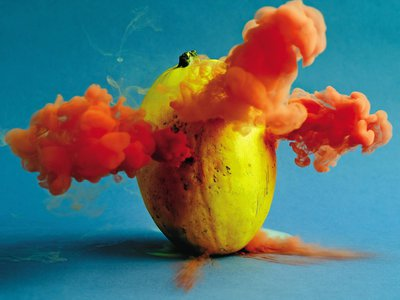 A spaghetti squash explodes with color. Maciek Jasik does not reveal his technique for making produce expel colorful smoke.