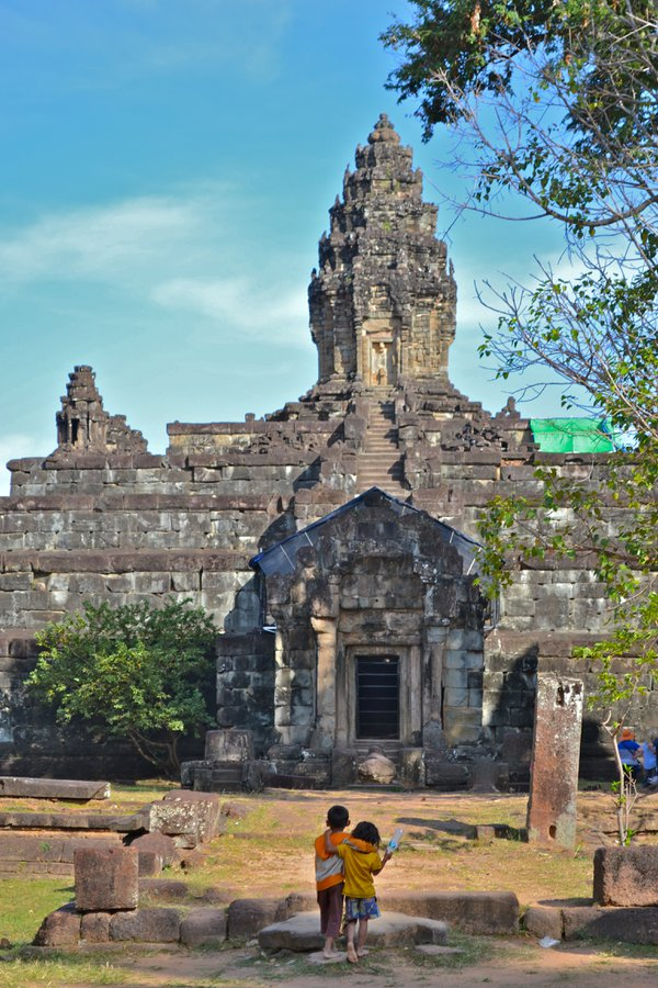 Two Cambodian children taking in the view of Bakong Temple thumbnail