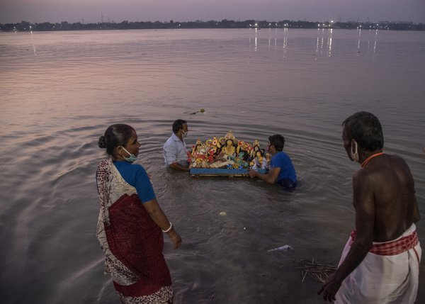 Devotees at Ganga river, performing immersion of Goddess Durga thumbnail