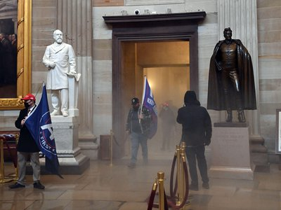Rioters enter the U.S. Capitol's rotunda as chemical irritants fill the corridor on January 6, 2021.