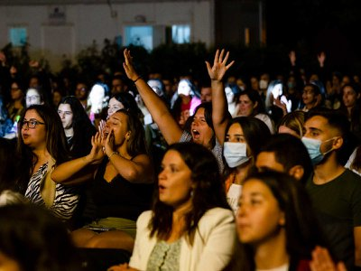 Concert attendees cheer at an event in Porto, Portugal, on August 15, 2020.