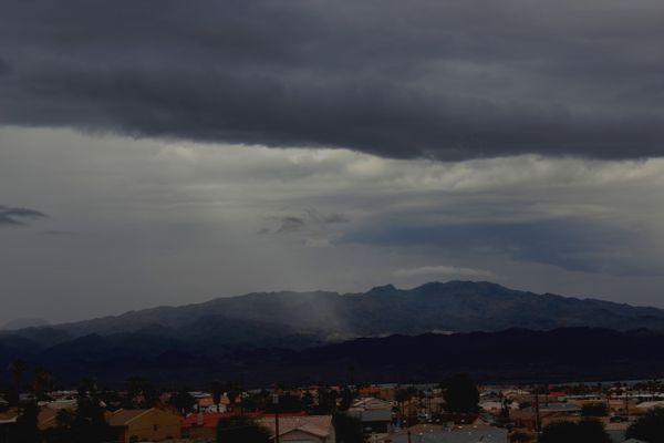 Ray of Sun Spotlight on the Mountain through the Monsoon thumbnail