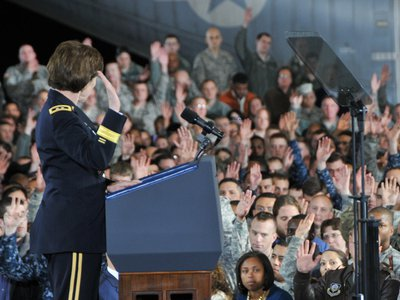 Previously deployed service members raise their hands at Joint Base McGuire-Dix-Lakehurst in New Jersey.