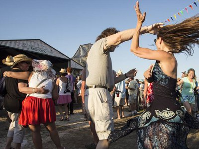 Revelers two-step at the New Orleans Jazz & Heritage Festival.