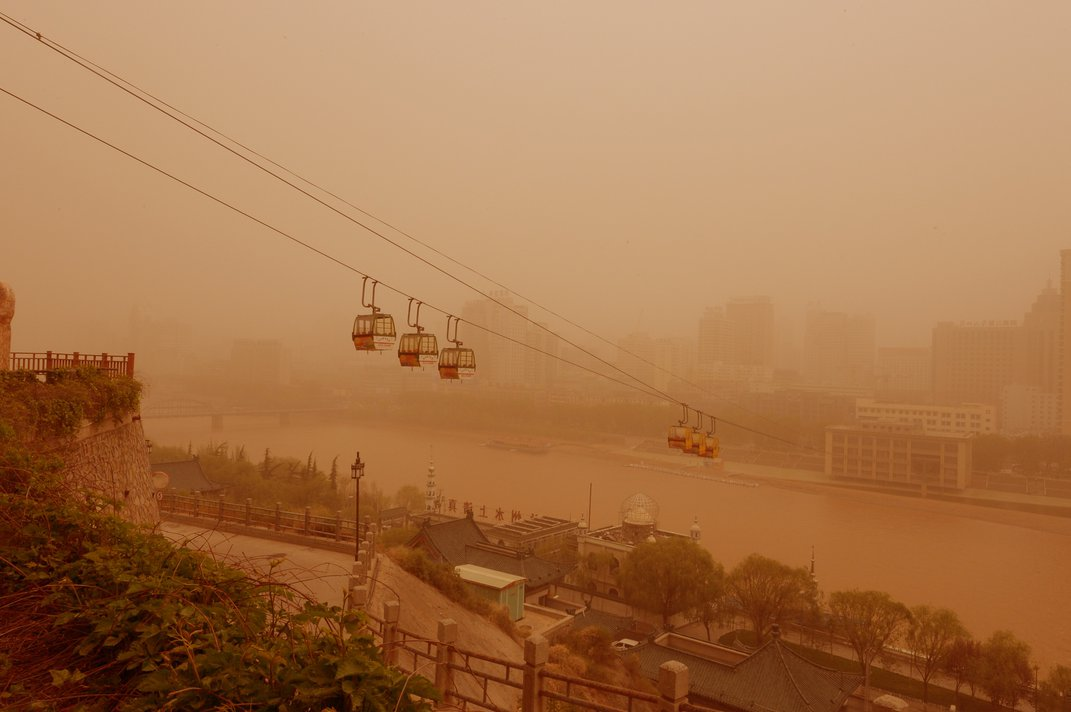 View of cable cars in a sandstorm in Lanzhou city, northwest Chinas Gansu province, 24 April 2014 Credit: Imaginechina/Corbis