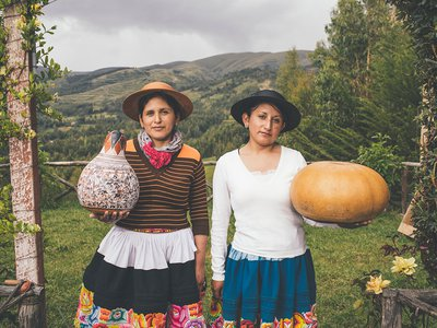 Katya and Blanca Canto pose with their carved gourds at their home in Cochas Grande.