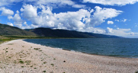 Desolate wilderness surrounds the giant Lake Baikal, the deepest, oldest and most voluminous lake on earth.