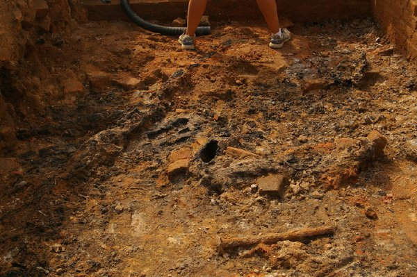 Excavation of the cellar of a burned 17th century building at jamestown, VA thumbnail