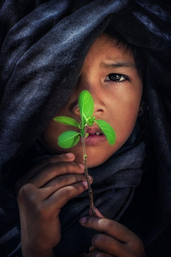 A child and green leave thumbnail