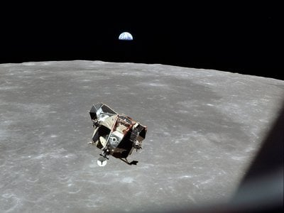 The lunar module <i>Eagle</i>, carrying Neil Armstrong and Buzz Aldrin, ascends back up to the command module <i>Columbia</i> with Michael Collins. It is often said that Michael Collins is the only human, living or dead, who is not in this photograph.